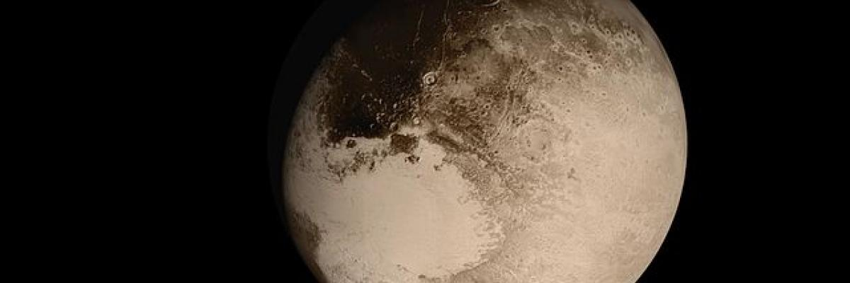 Pluto as viewed by New Horizons during flyby. Source [Wikimedia Commons]